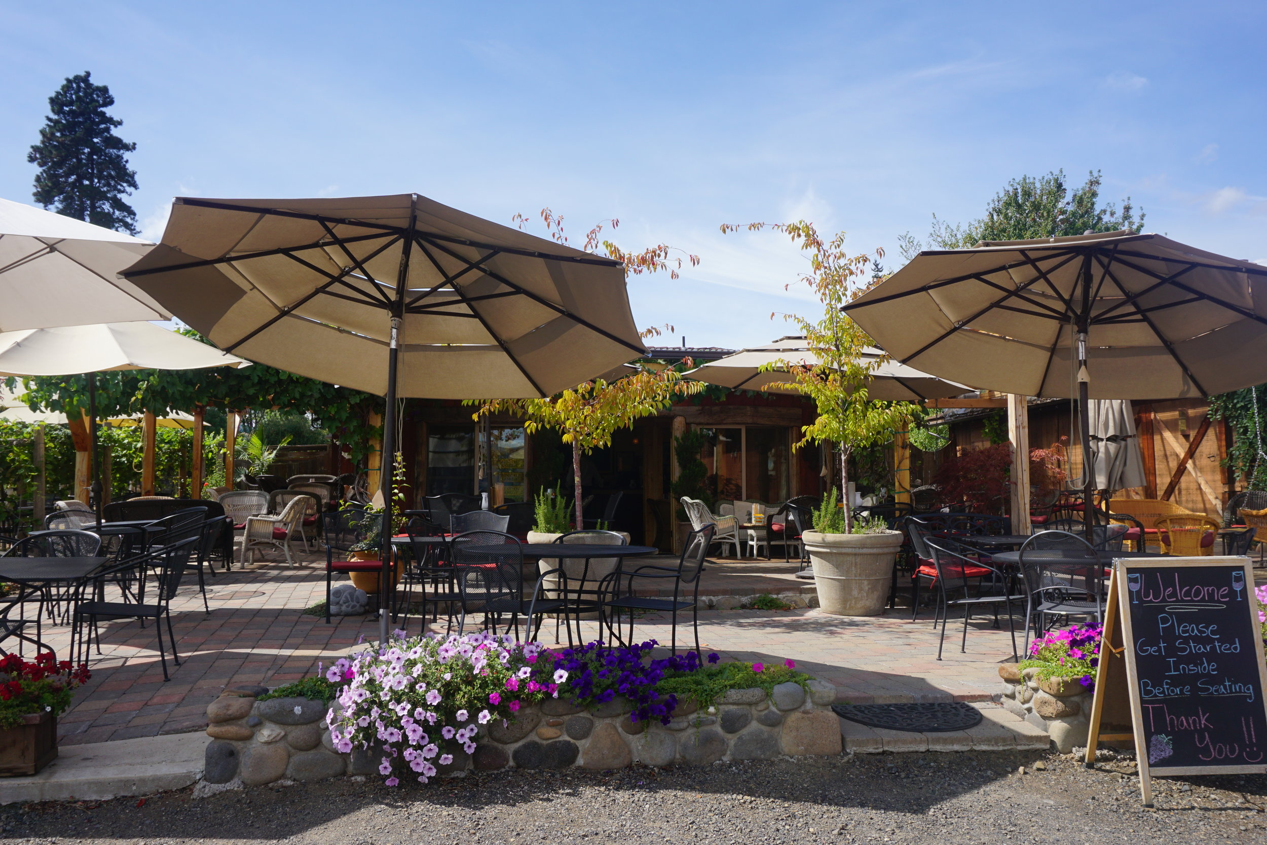 The tasting room at Hood River's Marchesi Vineyards pours outside under umbrellas and vine-strewn arbors on dry days. Viki Eierdam