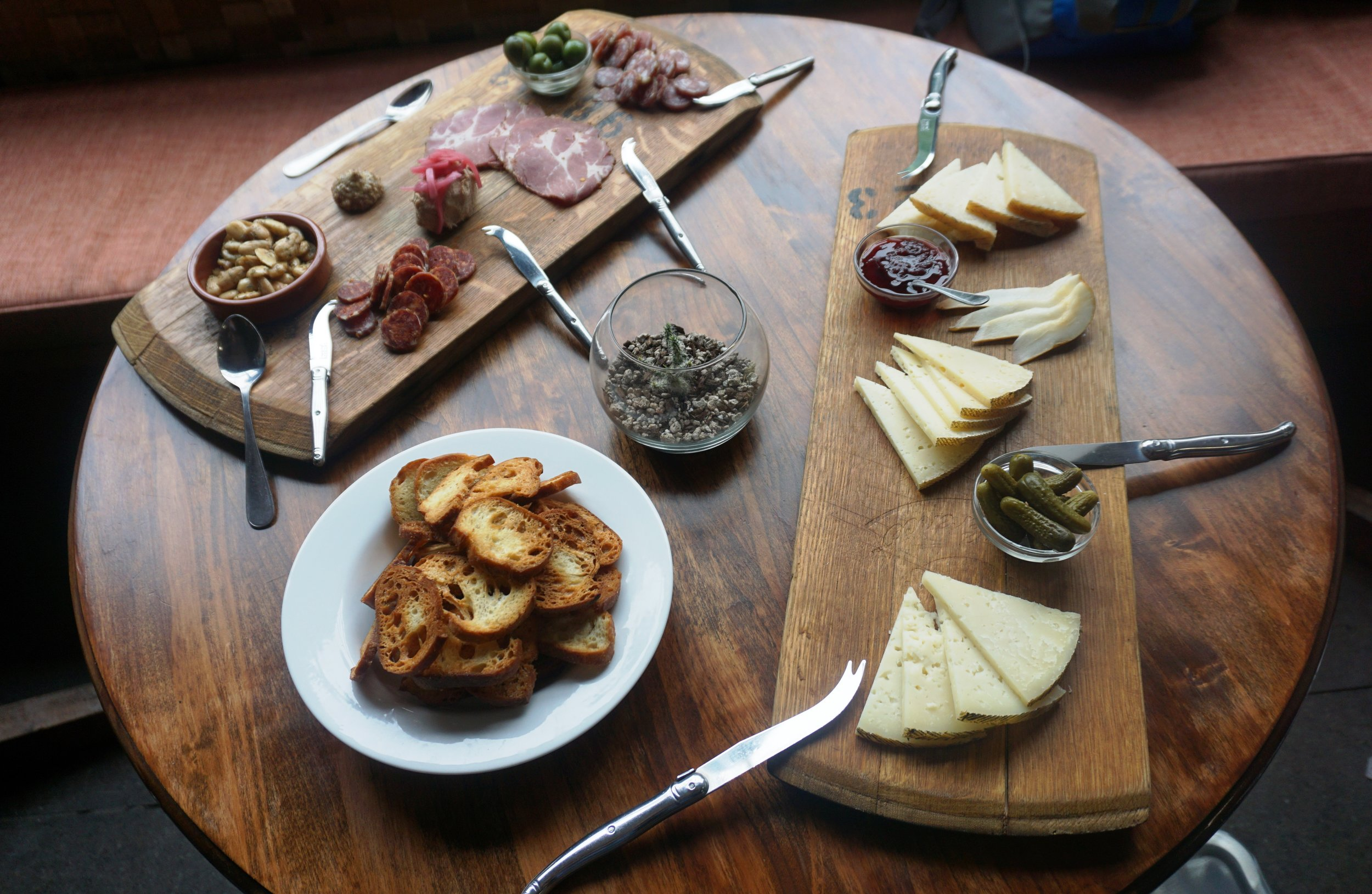 A sampling of Southeast Wine Collective's food menu includes Valencia almonds, house-made charcuterie, castelvetrano olives and cheeses sourced from nearby Cheese Bar. Viki Eierdam