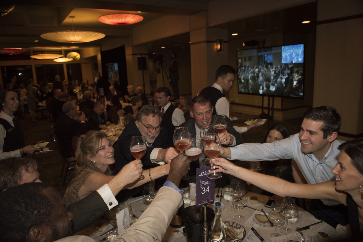 Mark and Vickianne Vlossak of St. Innocent Winery celebrate with guests at the Saturday Dinner and Auction Gala. Andrea Johnson Productions
