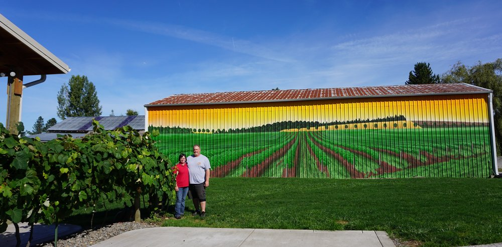 Julie and Steve, owners of Jacquot Farm and Vineyard, are conscious to hire local craftsmen for property projects like this eye-catching mural that graces one side of a large outbuilding. Viki Eierdam