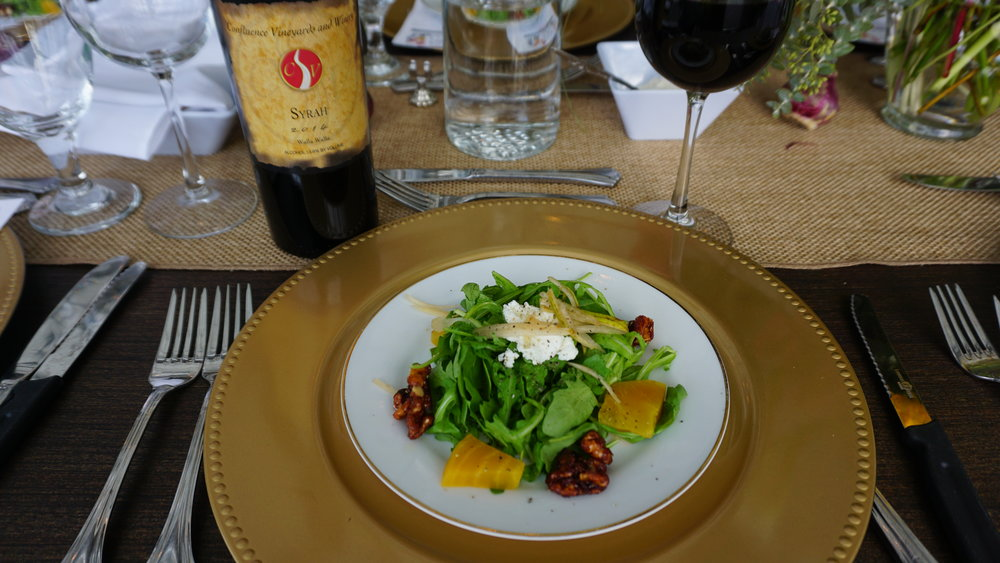 The spiciness in syrah—such as this Confluence Winery 2014 Syrah—is a beautiful opportunity to pair it with a peppery arugula salad topped with Cloud Nine Cumulus. Viki Eierdam