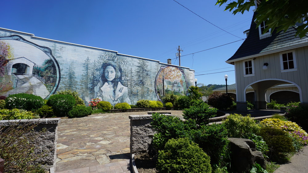A mural of Opal Whiteley, once the most popular teenager in Oregon and regaled as a literary genius by 13, stands at the corner of Main St and 7th in Cottage Grove. Viki Eierdam