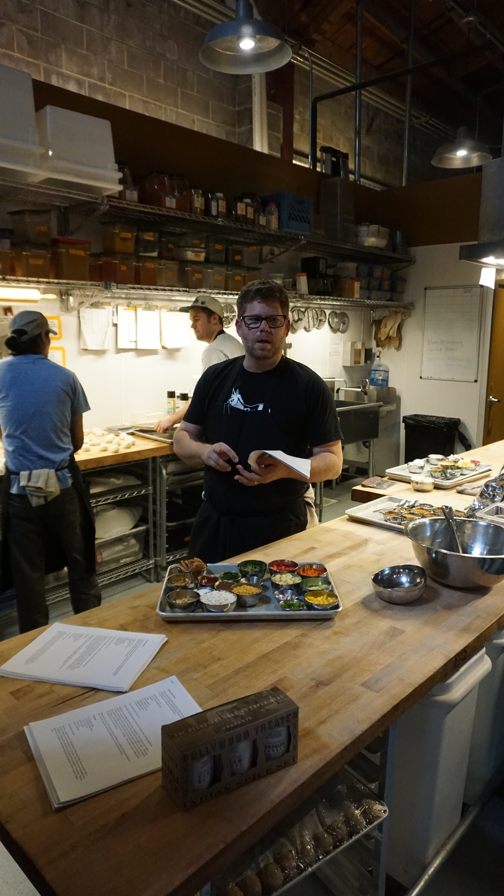 Chef Troy MacLarty goes over a menu item and its numerous ingredients at the Division kitchen of Bollywood Theater PDX. Viki Eierdam