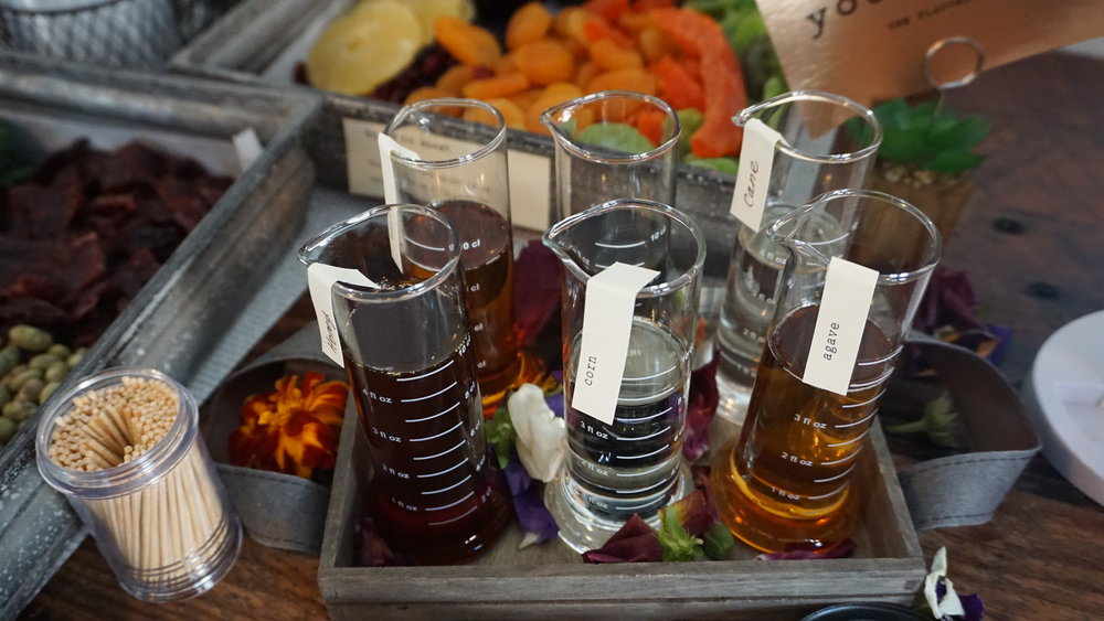 Spring's table of taste identifiers, including flasks of bitters, helps guests recognize some of the flavors and aromas in the wines. Photo by Viki Eierdam