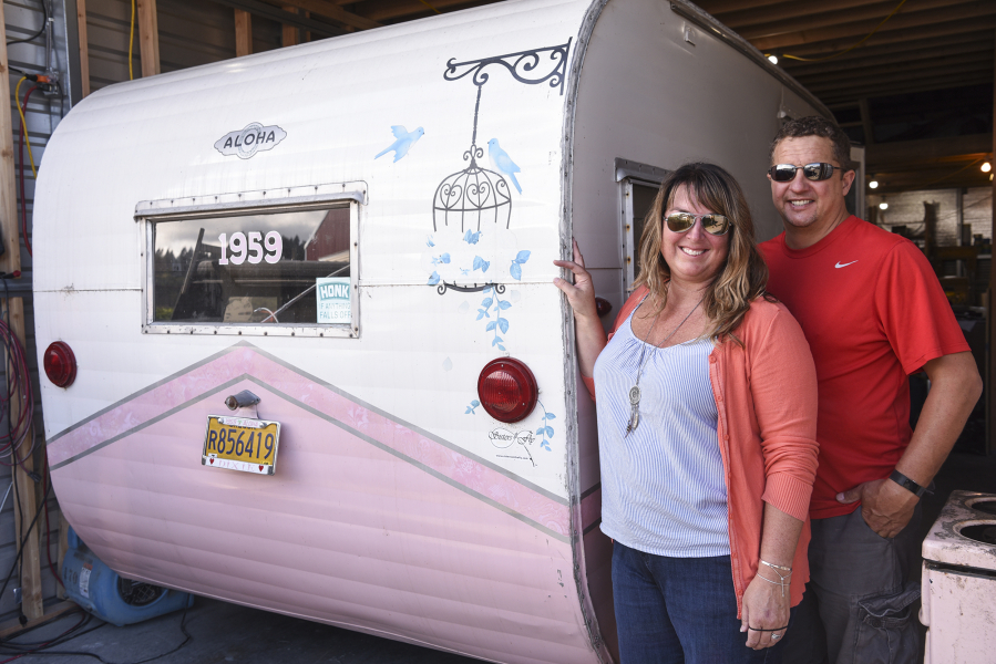 René Perret and Jeremy Ralston, owners of Down River Vintage Trailer Restoration, stand next to a 1959 Aloha trailer they're renovating in their shop in Woodland. Photos by Ariane Kunze/The Columbian