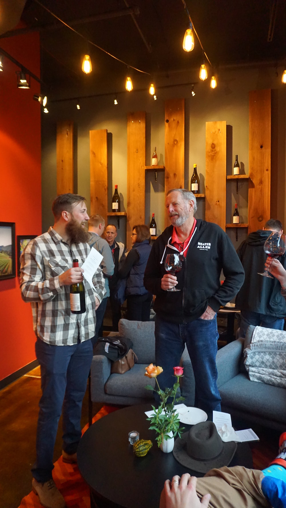 Alex Fullerton talks with a guest at the winery's new tasting room on Pettygrove in Portland. Viki Eierdam