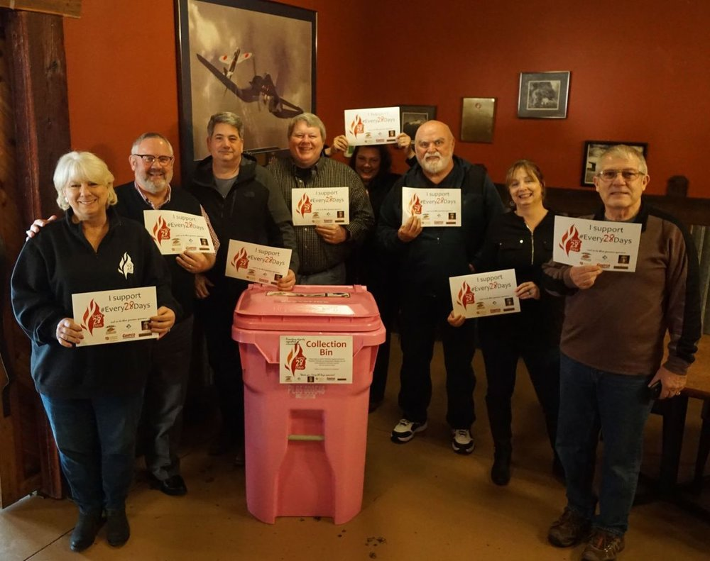 Lisa Goodrich (left) gathered with a group of community supporters at Mill Creek Pub, one of the official drop sites for donated product and one of the two places holding a Period Party of Feb. 28. Viki Eierdam