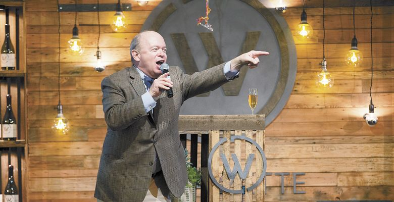 Auctioneer Fritz Hatton playfully prods the audience for higher bids at this year's Willamette: The Pinot Noir Auction.Photo by John Valls
