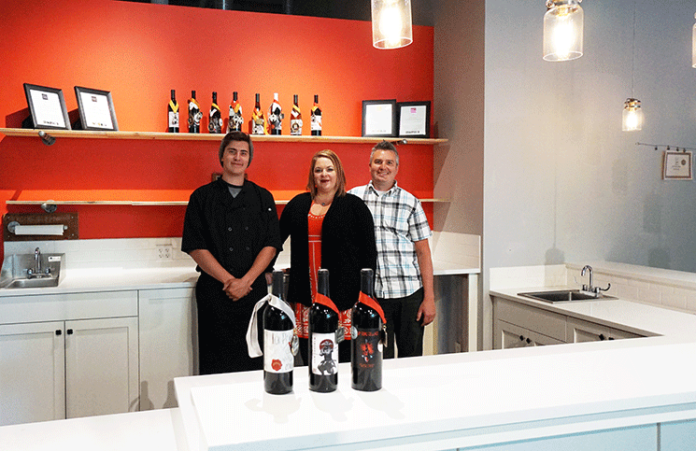 Pictured, from left to right, are Ty Parker (son and sous chef), and wife and husband owners of Koi Pond Cellars, Michelle and Wes Parker. Courtesy of Viki Eierdam