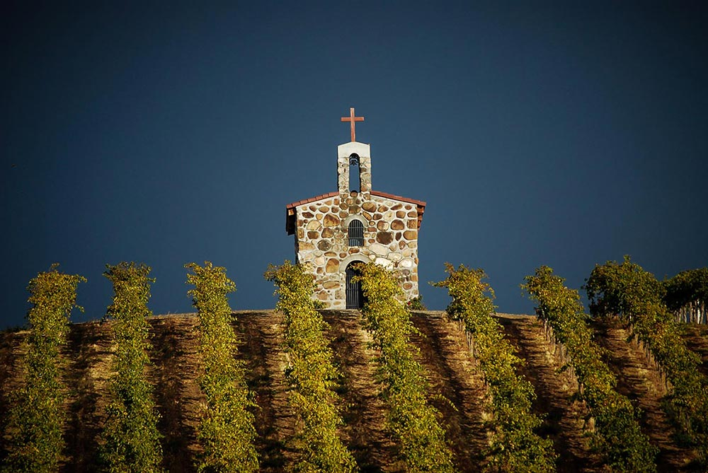 With Mt. Adams looming in the background, the iconic prayer chapel at Red Willow Vineyard stands atop the hillside that is planted with the oldest Syrah grapes in the State of Washington. Courtesy photo