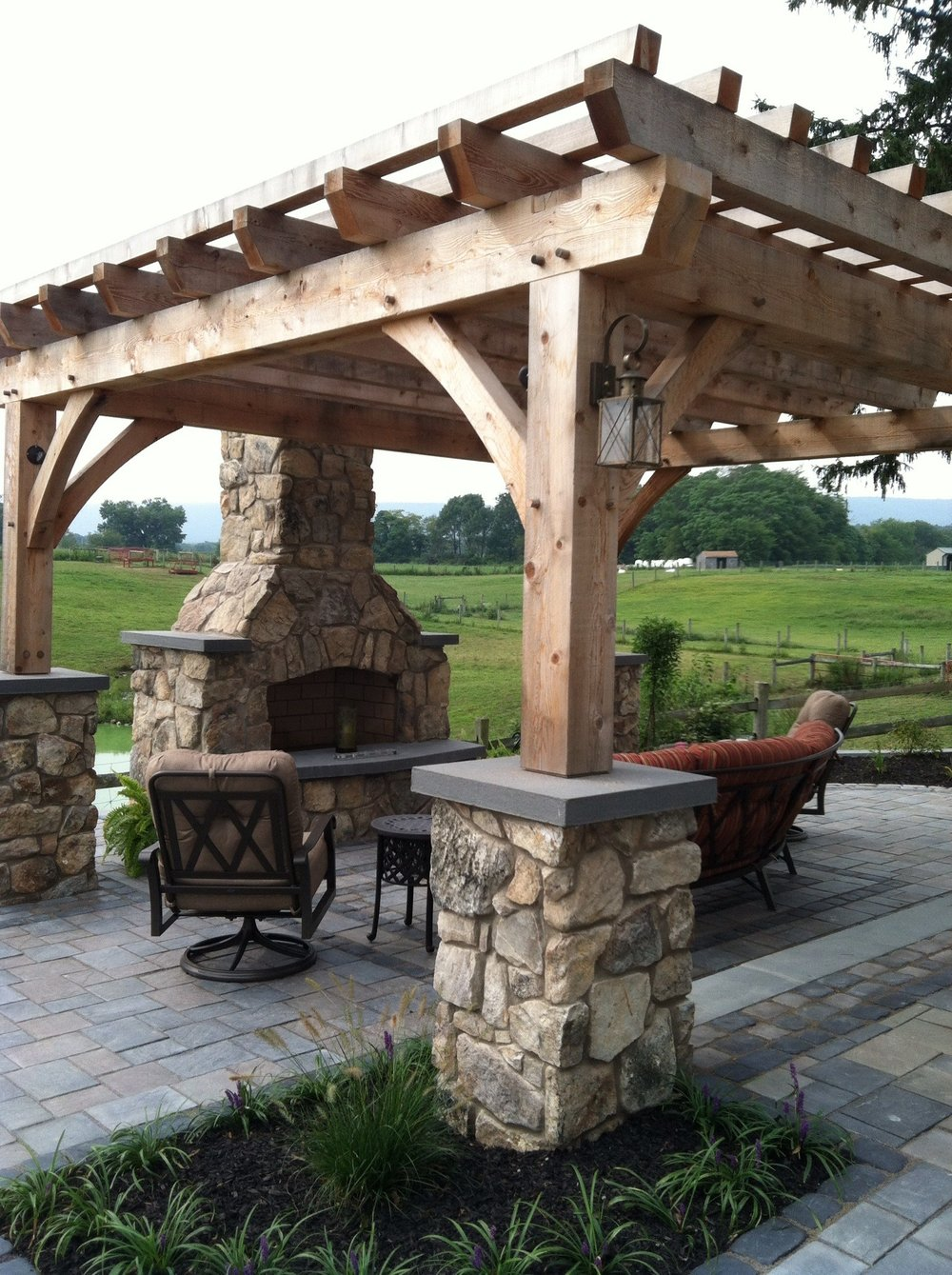 Top landscape design with an outdoor fireplace in Lebanon, PA