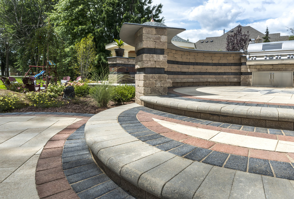 How a Landscape Contractor Can Improve Your Backyard with Steps and Walls in Reading, PA