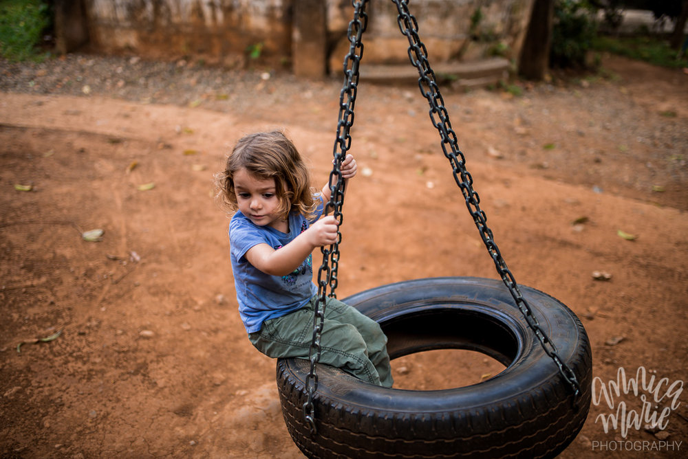 toddler on a tire swing