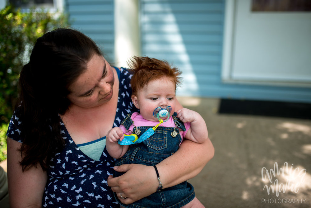 mom and red haired baby on front porch