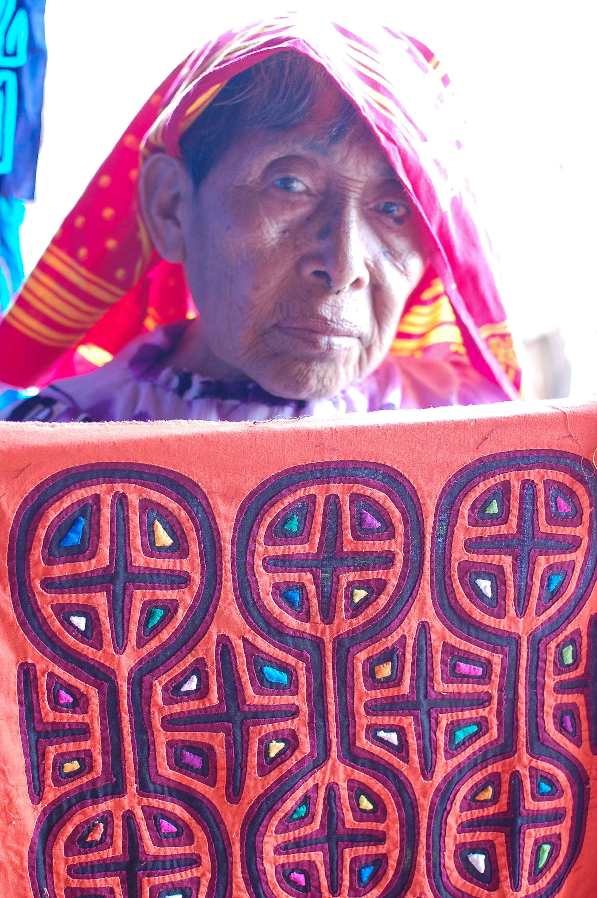 A Kuna woman holding one of RoadsWellTraveled's favourite pieces called 'Maracas'