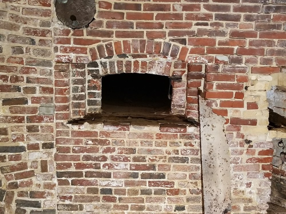 The veneer of this 1700's oven was pragmatic--brick with no unnecessary details. You may want to mimic this brick style by using old brick and lime plaster. Don't worry: we'll clean the mortar off the brick if you want.