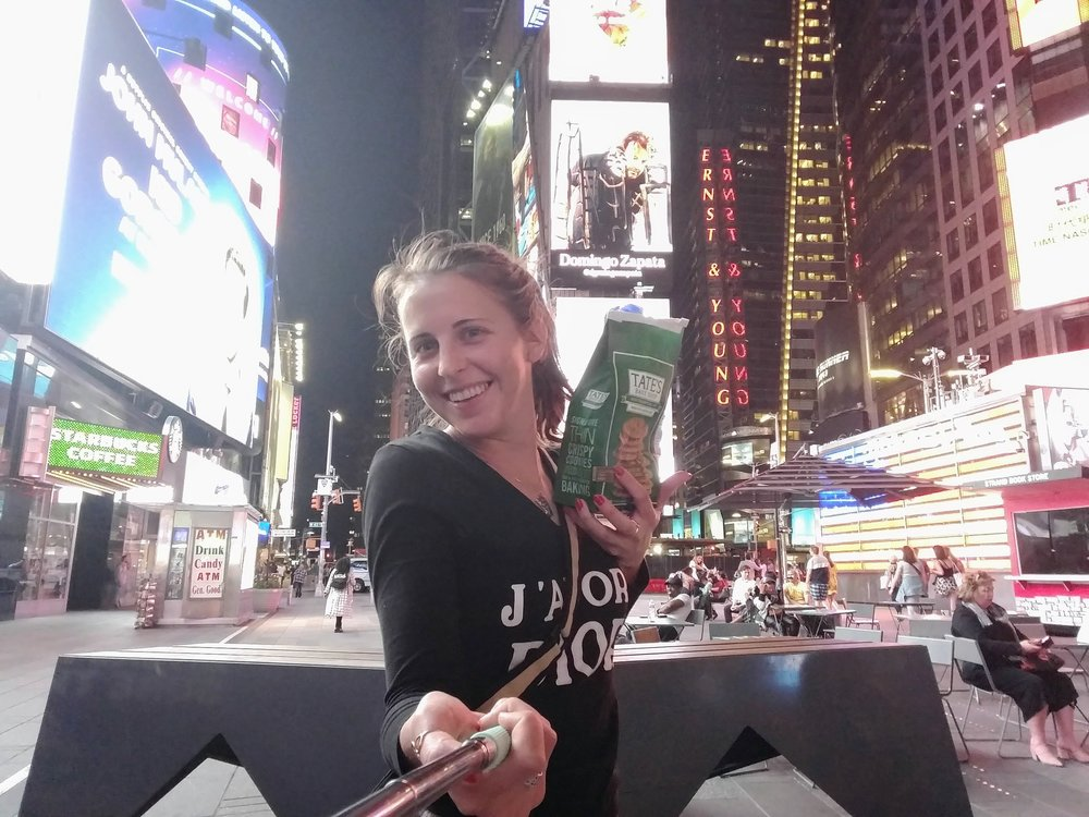 Delivering some cheese featuring a selfie stick, snacks, and Times Square