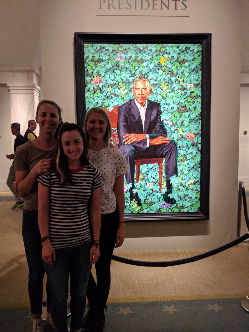 Group photo in front of Obama's lovely portrait by Kehinde Wiley