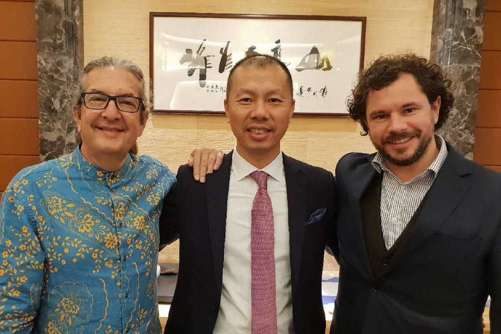 It's high time for tea: The Tea House and Gallery's Stephen Carrol, with Mr Yang, and Owen Terry.