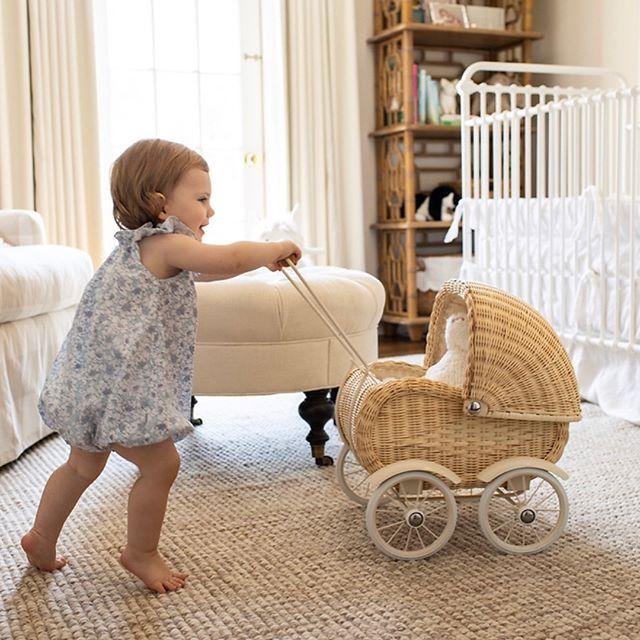 Our favorite little client enjoying her beautiful room! . . . . . #whitedecor #nurserydecor #nursery #babydecor #smallspacesquad #nurseryinspo #interiordesign #kidsroom #kidsinteriors  #girlsroom #legler #pram #leeindustries