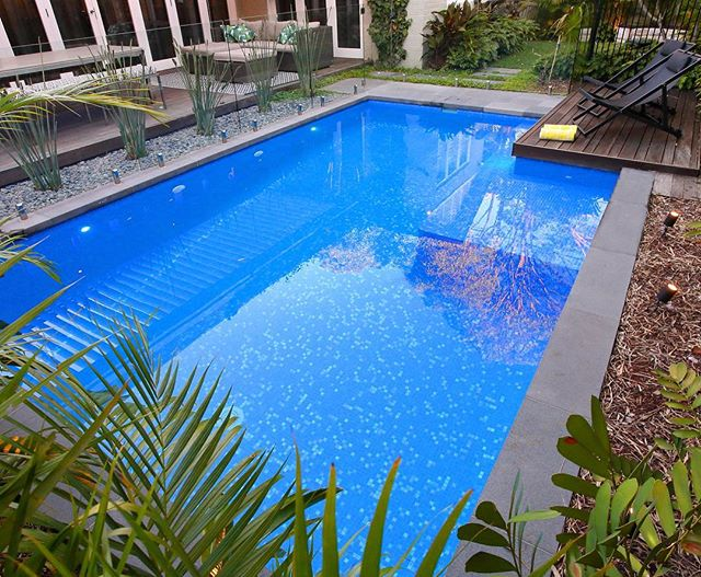 Wonderful design and landscaping from Our friends at @growingrooms on our Northbridge Project. The pool and alfresco fill the back garden space really well, with some clever extras such as a fire pit and bench for those cold winter nights. #swimmingpool #landscaping #alfresco #malibupoolsnsw #tiling #glassfencing #firepit
