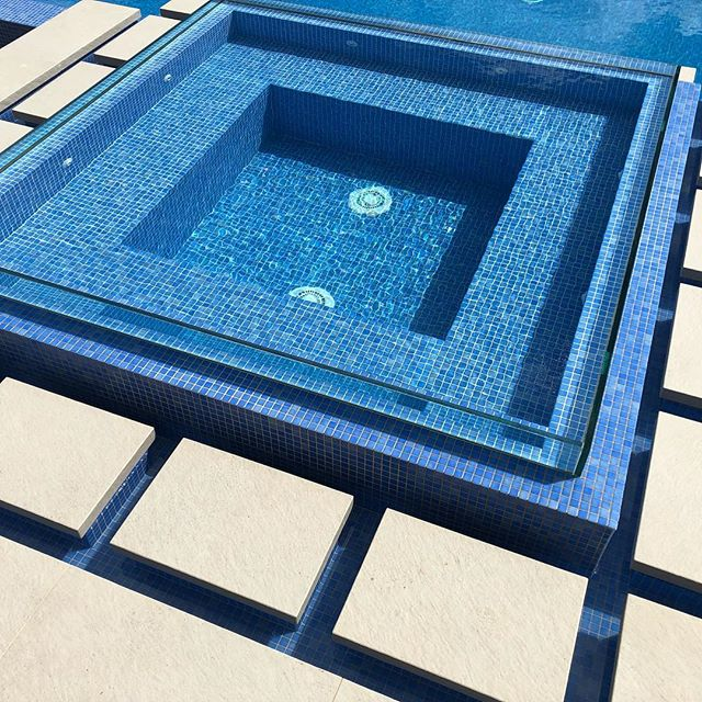 We're excited to be nearing the end of our Kenthurst project with a raised glass-edge spa surrounded by steppers. #malibupools #acreagepools #glassspa #tiledspa #tiledpool #kenthurstpool