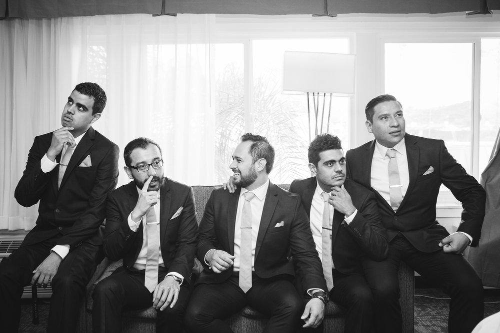 6abe6-elegant-country-charm-ranch-wedding-groomsmen-contemplating-important-things-like-who-has-the-ring.jpg
