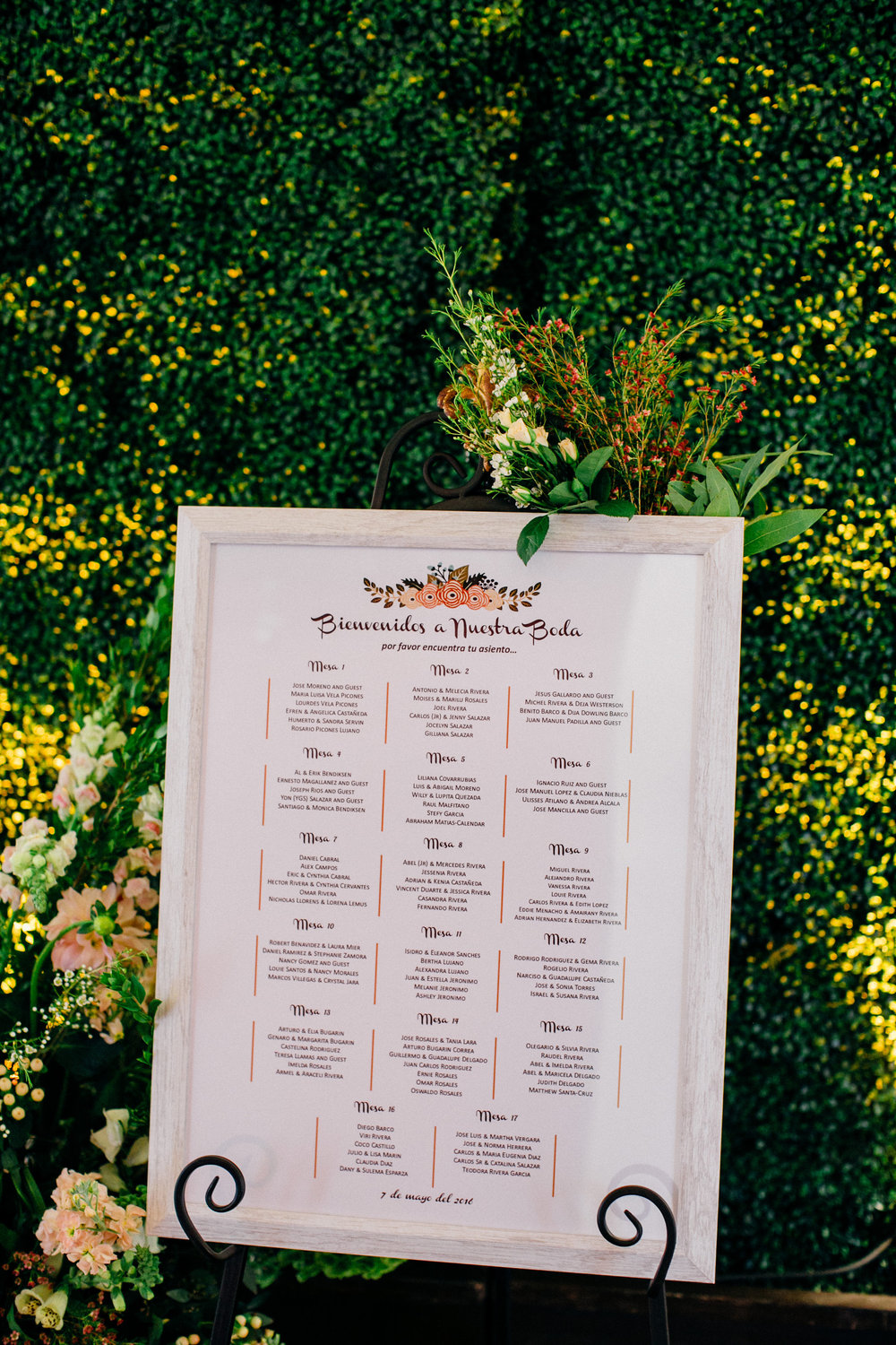 9cfc4-elegant-country-charm-ranch-wedding-seating-chart-flanked-by-flowers.jpg