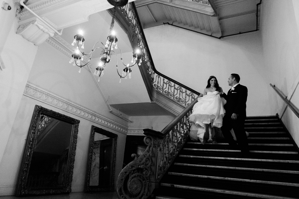 06294-pretty-in-pink-vintage-hollywood-fiesta-wedding-alexandria-ballroom-ornate-staircase.jpg