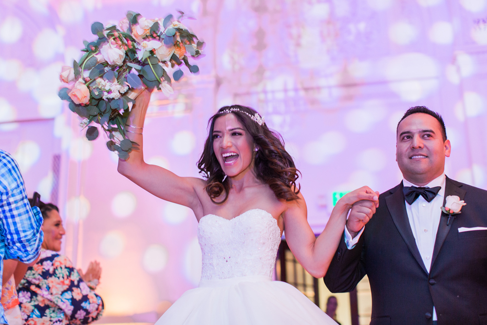 2fa0f-pretty-in-pink-vintage-hollywood-fiesta-wedding-alexandria-ballroom-palm-court-room-enter-bride-and-groom.jpg