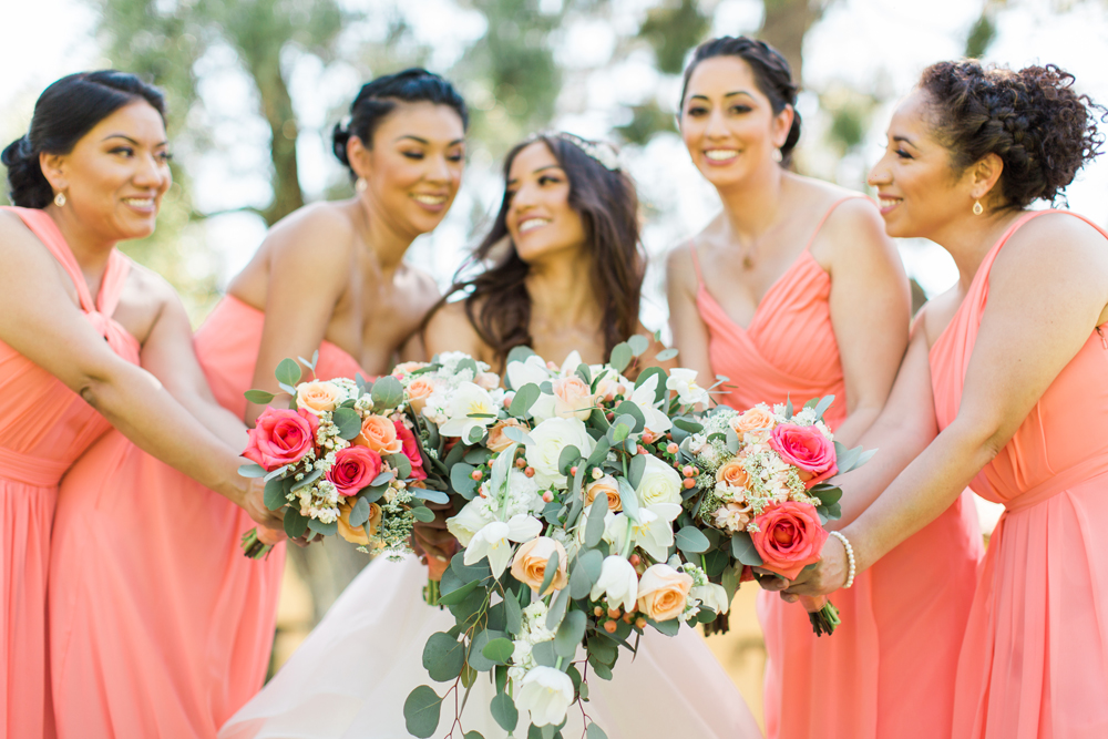 3612b-pretty-in-pink-vintage-hollywood-fiesta-wedding-bride-and-maids-showing-bouquets.jpg