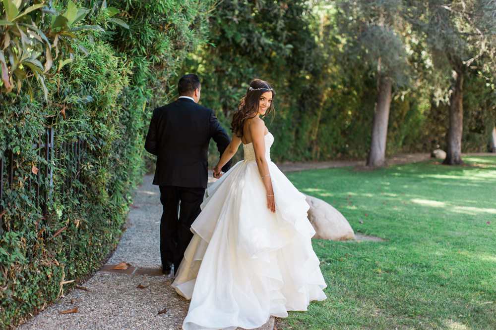 4b43b-pretty-in-pink-vintage-hollywood-fiesta-wedding-bride-and-groom-walking-together.jpg
