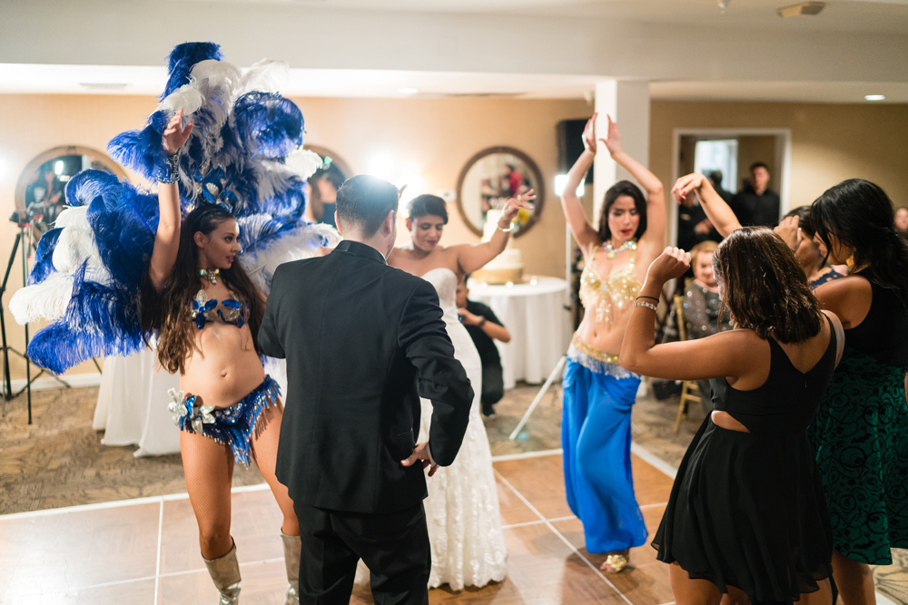 7cd61-lively-navy-yellow-harbor-wedding-belly-dancers-dancing-with-guests.jpg