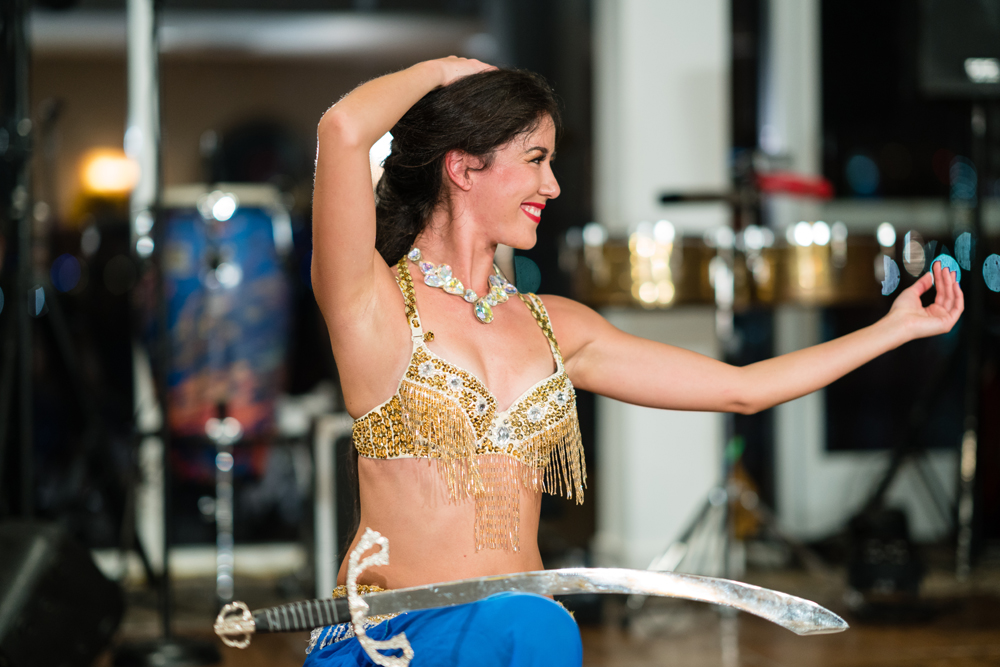874e1-lively-navy-yellow-harbor-wedding-belly-dancer-dancing-with-sword.jpg