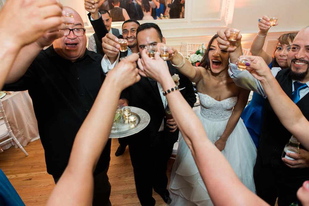 909ca-pretty-in-pink-vintage-hollywood-fiesta-wedding-alexandria-ballroom-palm-court-room-tequila-shot-cheers.jpg
