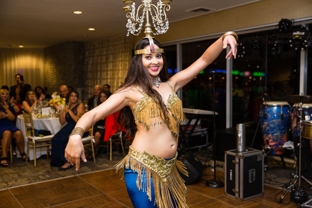 b8c3c-lively-navy-yellow-harbor-wedding-belly-dancer-dancing-with-candelabra-on-her-head.jpg