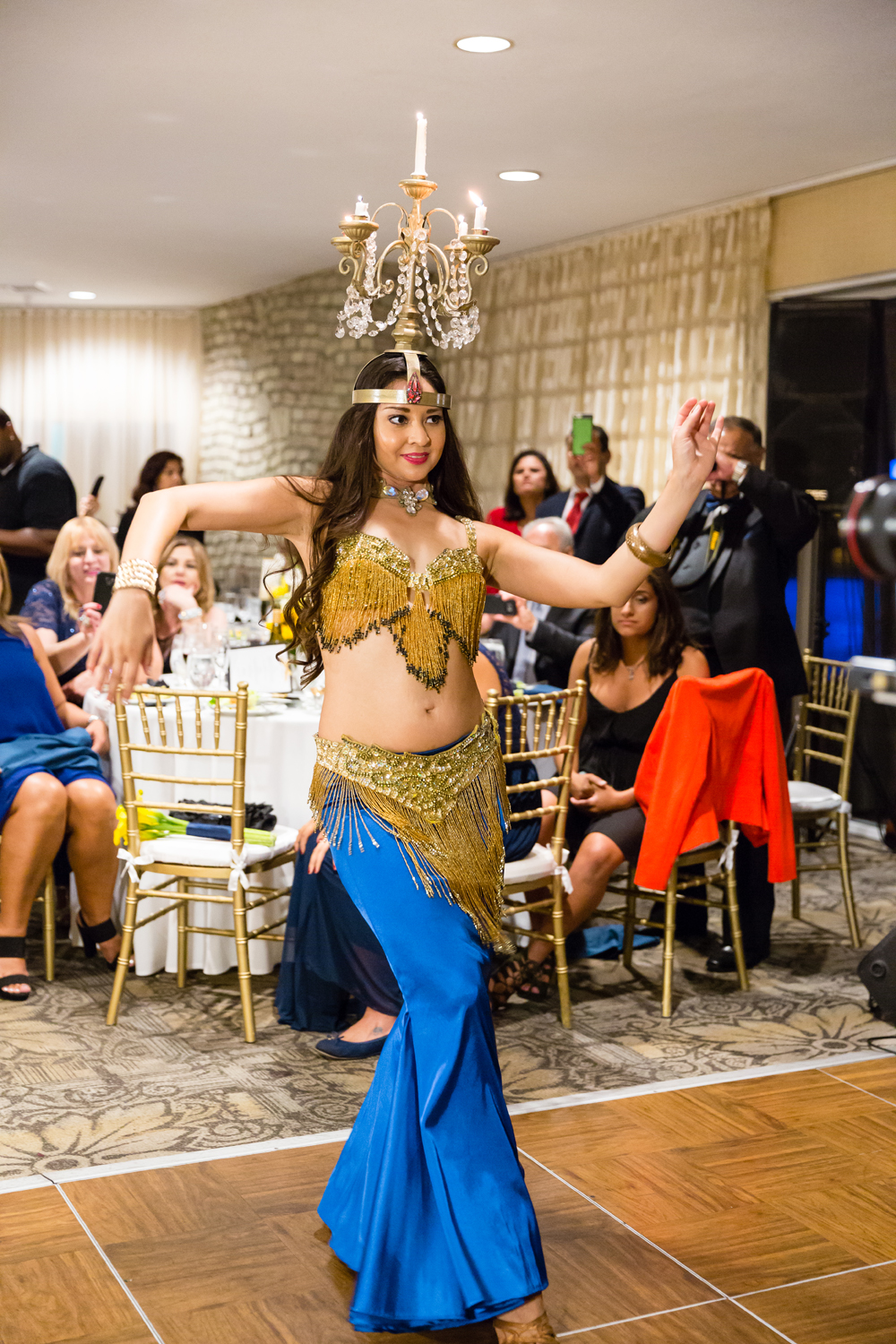 c4aed-lively-navy-yellow-harbor-wedding-belly-dancer-at-reception-candelbra-dance.jpg