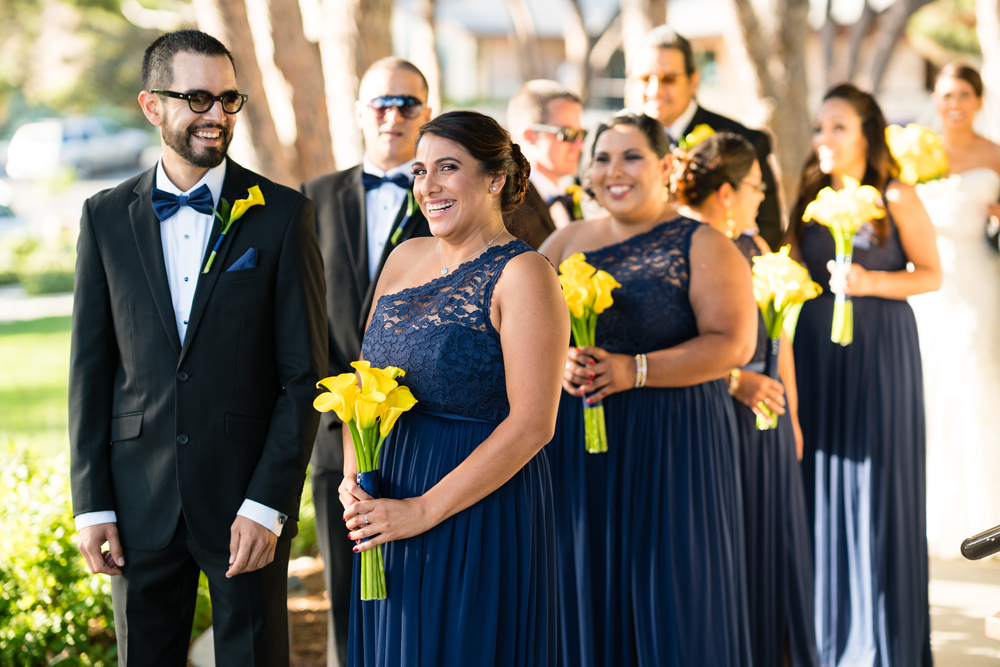 c76d7-lively-navy-yellow-harbor-wedding-happy-bridesmaids-with-sunny-bouquets.jpg