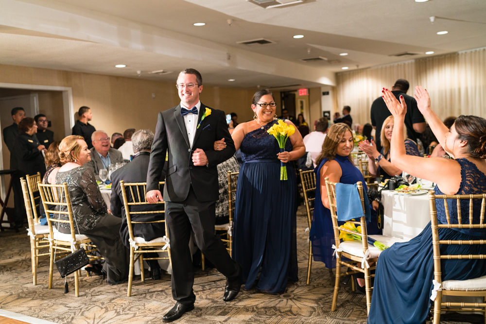 cd52f-lively-navy-yellow-harbor-wedding-bride-and-groom-entering-reception-with-belly-dancers.jpg