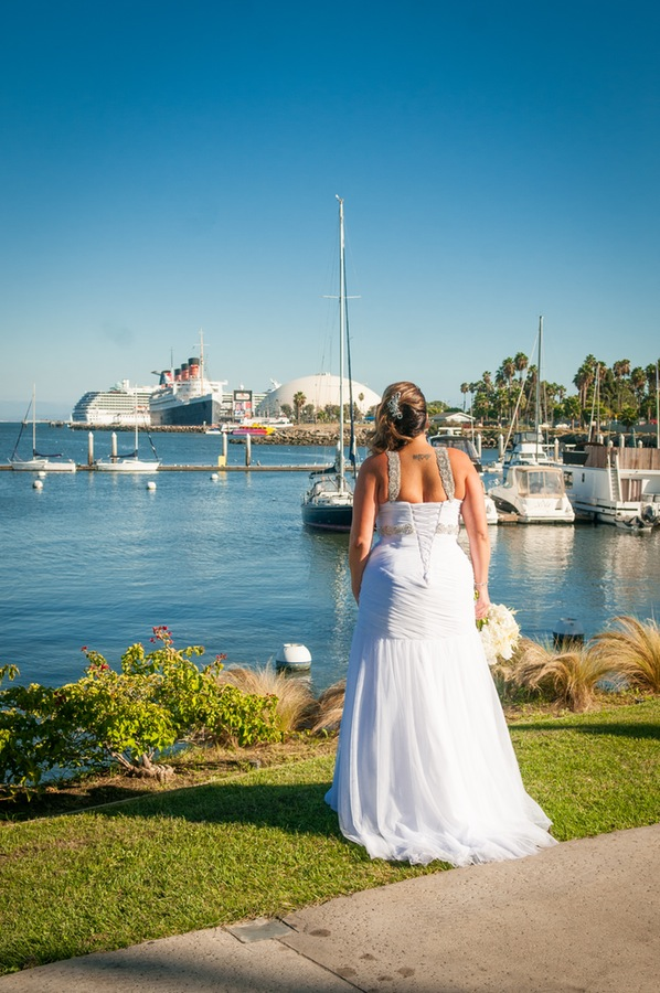 2595e-beautiful-joyful-harborside-wedding-bride-looking-out-over-harbor-and-queen-mary.jpg