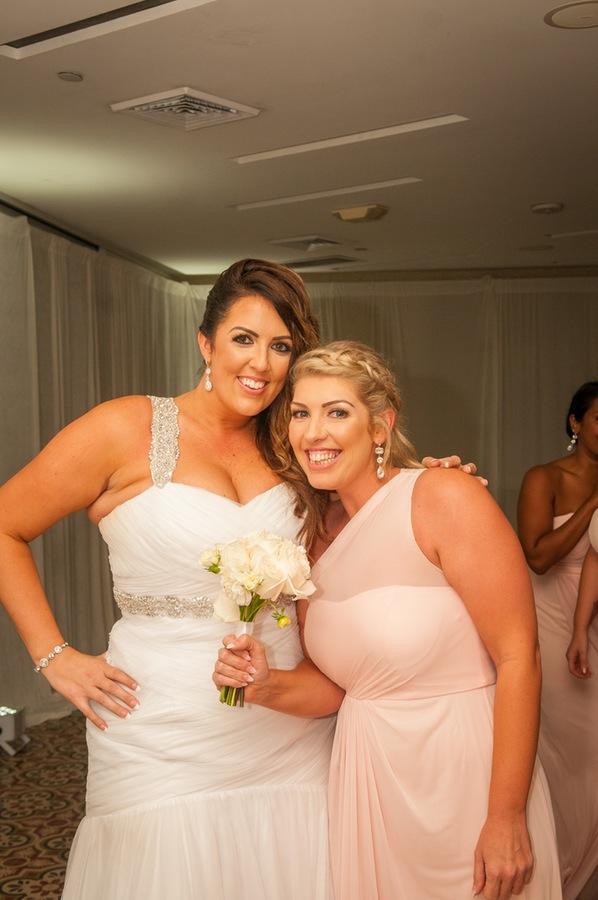 3b34e-beautiful-joyful-harborside-wedding-bride-and-bridesmaid-with-bouquet.jpg