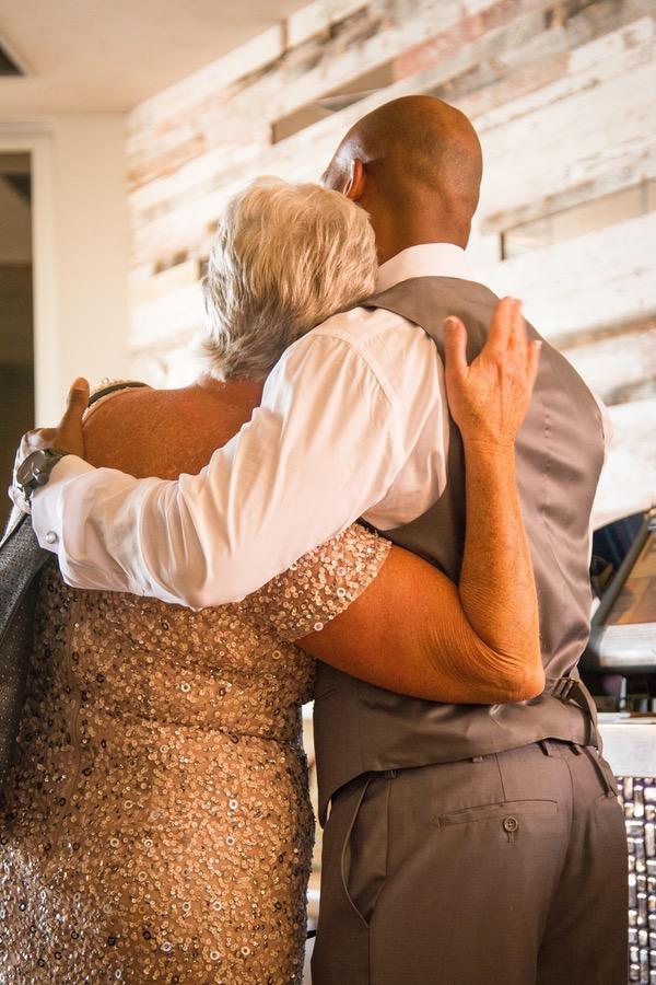 7193a-beautiful-joyful-harborside-wedding-groom-and-mother-in-law-sweet-hug.jpg