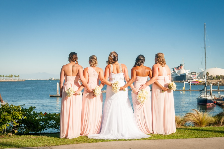 8621e-beautiful-joyful-harborside-wedding-bride-and-her-bridesmaid-looking-overlooking-harbor.jpg