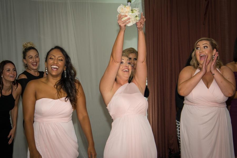 9aca3-beautiful-joyful-harborside-wedding-bridesmaid-catching-bouquet.jpg