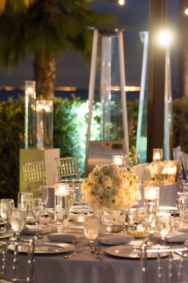 b5212-beautiful-joyful-harborside-wedding-large-white-roses-centerpieces.jpg