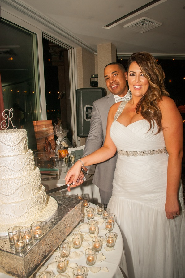d9ab0-beautiful-joyful-harborside-wedding-cutting-of-the-cake.jpg