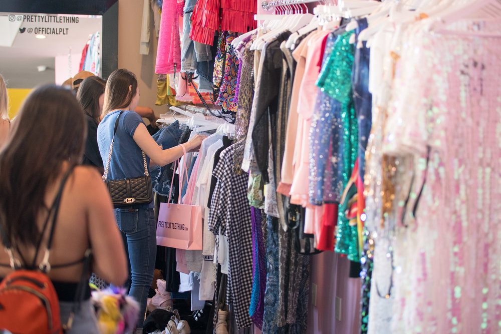 Peek Inside Celebrity Pre-Coachella Gifting Suite so many PLT outfits to choose from.jpg