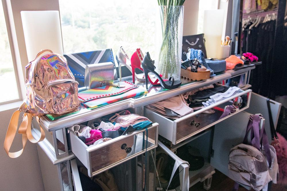 Peek Inside Celebrity Pre-Coachella Gifting Suite metallic backpacks high heels sexy lingerie.jpg