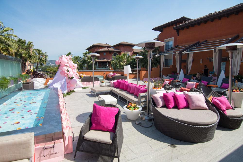 Peek Inside Celebrity Pre-Coachella Gifting Suite PLT pink poolside party.jpg