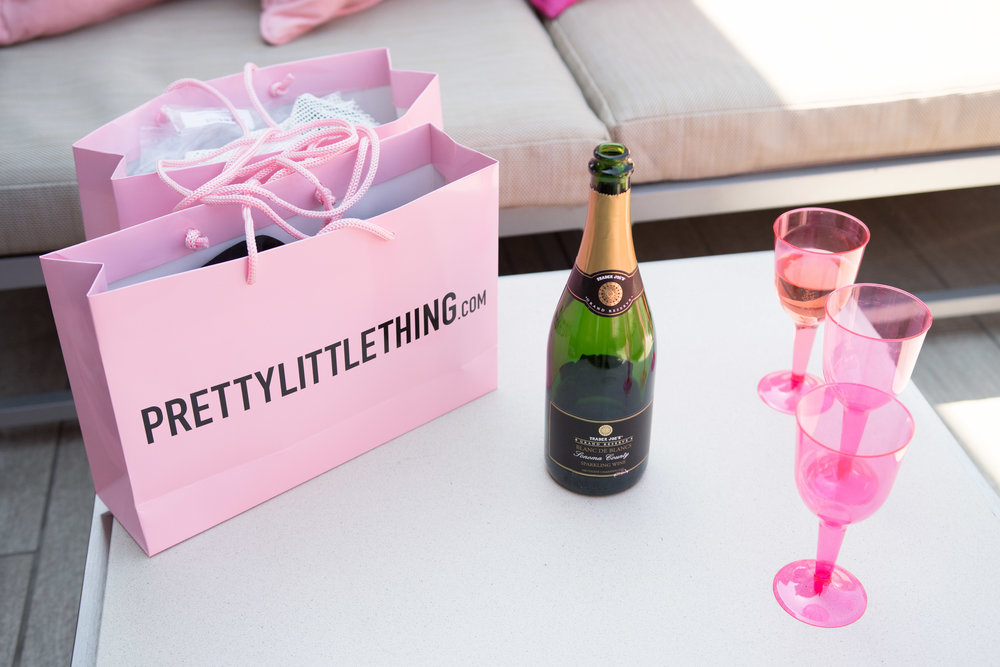 Peek Inside Celebrity Pre-Coachella Gifting Suite champagne and shopping.jpg